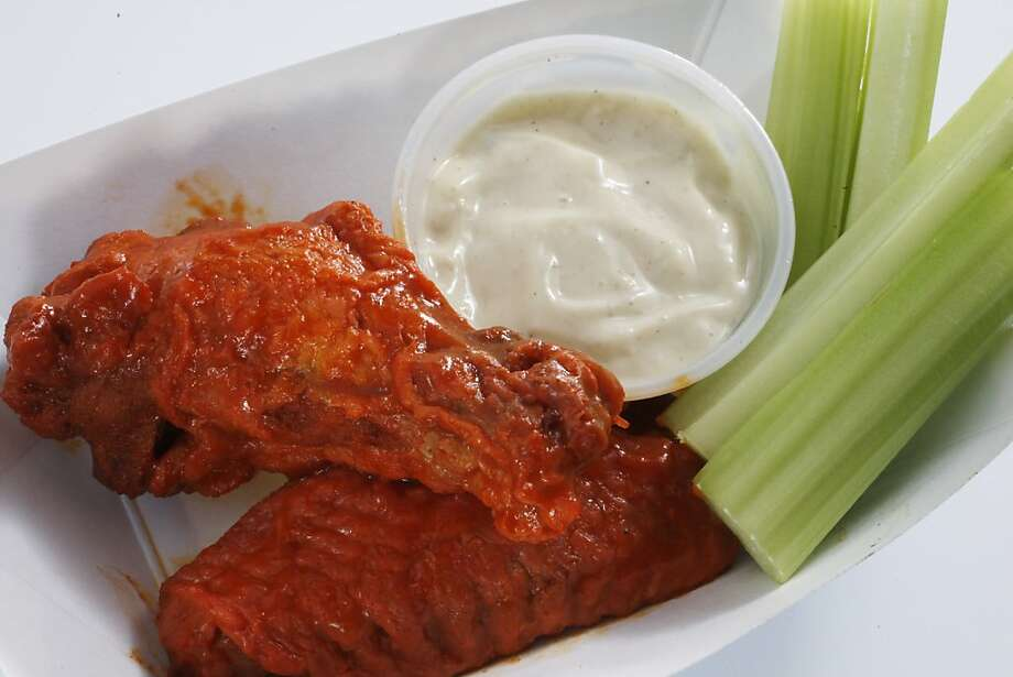 It wouldn't be a football party without buffalo wings. Why buy them when you can make your own buffalo wings with blue cheese bacon dressing? Photo: Eric Luse, The Chronicle