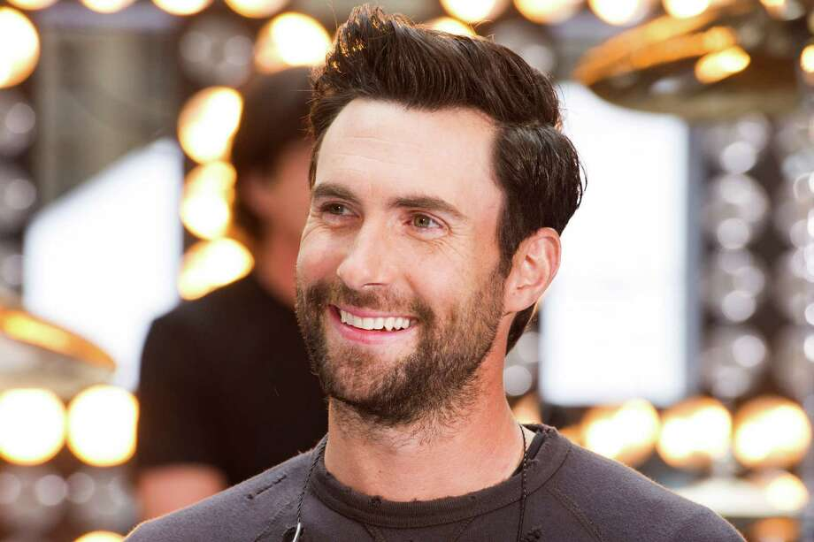 "FILE - In this June 14, 2013 file photo, Maroon 5 lead singer Adam Levine appears on NBC's ""Today"" show in New York. Levine previewed his menswear line for Kmart for a small group of fashion insiders on Tuesday, Sept. 3. Henley Ts, plaid button-down shirts, baseball caps and a camouflage cargo jacket were part of the collection that will land in 500 stores on Oct. 1.  (Photo by Charles Sykes/Invision/AP, File) ORG XMIT: NYET136 Photo: Charles Sykes / Invision"