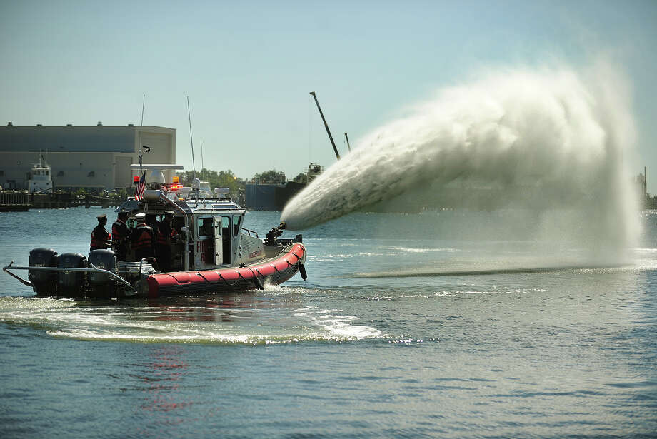 The Bridgeport Fire Department's new fire boat demonstrates the capabilities of its 2,000 gallons per minute water cannon during a tour of Bridgeport Harbor on Wednesday, September 4, 2013. Photo: Brian A. Pounds / Connecticut Post