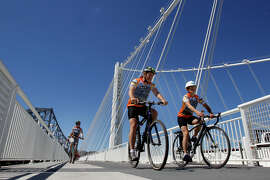 Cyclists rode by the suspension tower on the first day of operation Tuesday September 3, 2013. The Alexander Zuckermann bicycle and pedestrian path on the new eastern span of the Oakland Bay Bridge was opened Tuesday.