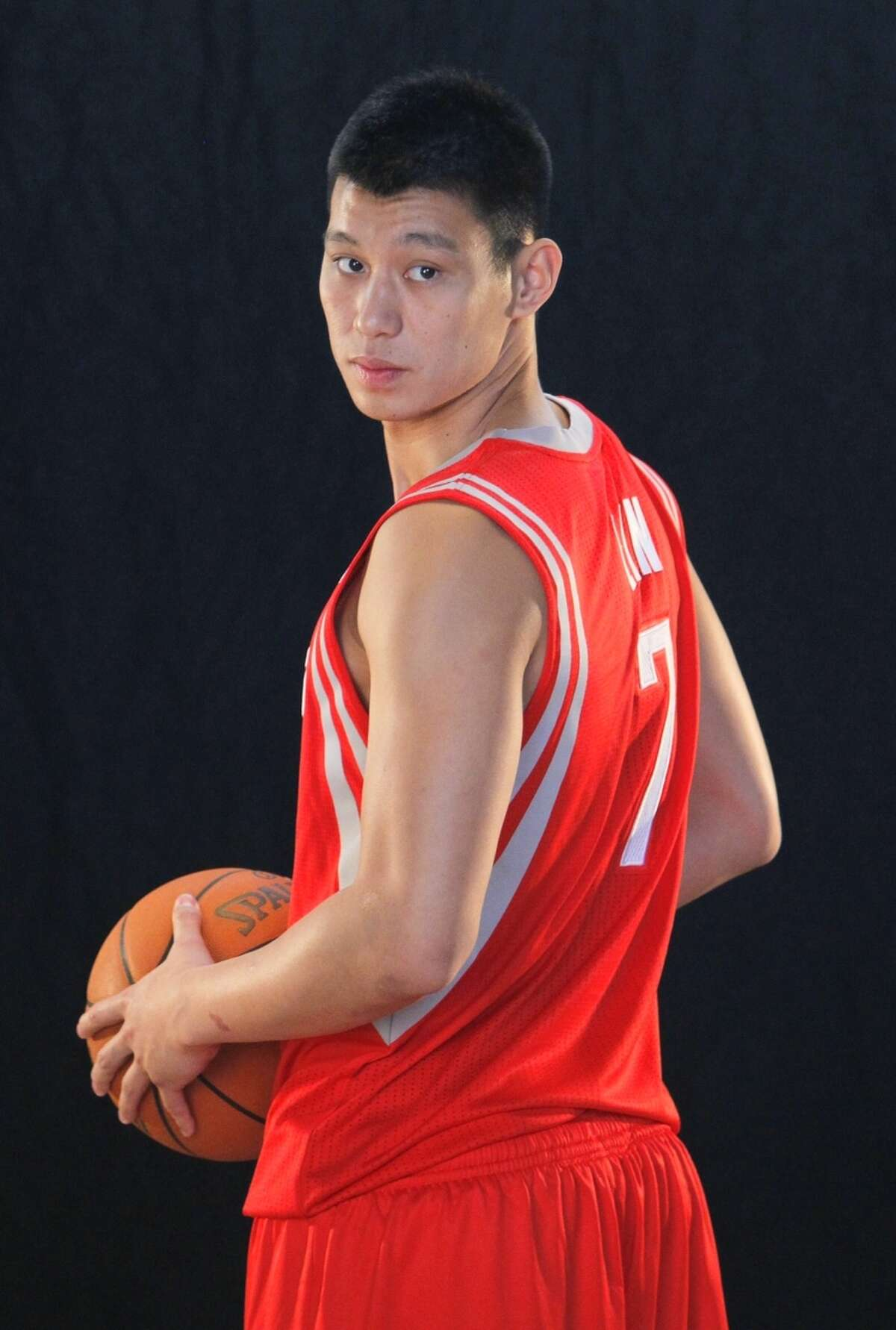 Sporting his new No. 7 jersey, Jeremy Lin poses for a photo on Thursday.