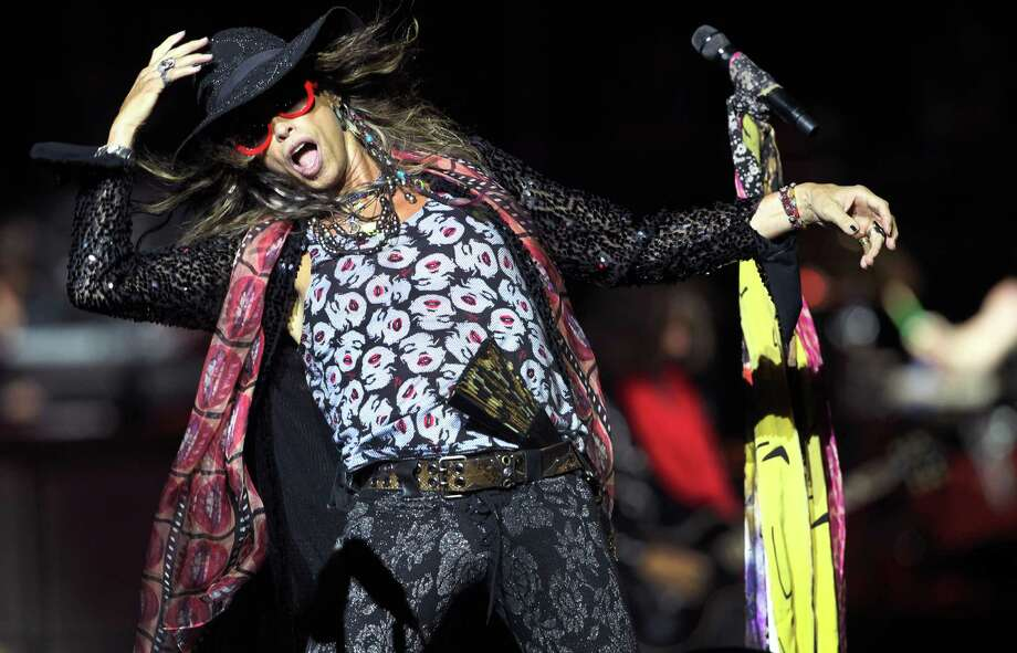 "FILE - This May 25, 2013 file photo shows Steven Tyler, lead singer of American rock band Aerosmith performing in Singapore during the inaugural Social Star Awards concert. Tyler made a surprise appearance at the Bluebird Cafe in Nashville on Tuesday, Sept. 3, and performed two songs. Tyler was in the audience watching four Nashville songwriters perform, including Marti Frederiksen. Frederiksen invited Tyler into the center of the venue to sing ""Jaded,"" which Frederiksen co-wrote, and then Tyler jumped on a piano to belt out the band's power ballad ""Dream On."" (AP Photo/Wong Maye-E, File) ORG XMIT: NYET137 Photo: Wong Maye-E / AP"