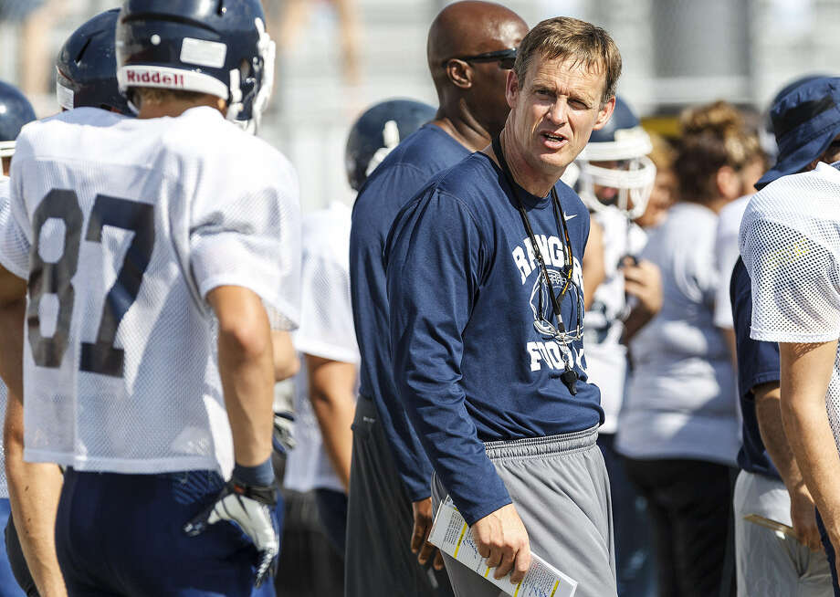 "Smithson Valley Head Coach Larry Hill talks with players on the sidelines during a scrimmage in late August. Hill acknowledged the high school has lost some quality players and there's ""a little more uncertainty"" at the start of this season compared to previous years. Last year, the team won the district title. Photo: Marvin Pfeiffer / Bulverde News"