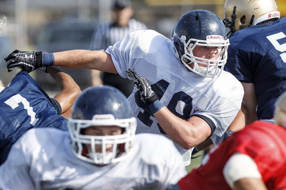 Smithson Valley defensive end Tyler Matthews, now with a year of experience under his belt, fights his way toward the play during an Aug. 23 scrimmage. Matthews is looking forward to an exciting senior year. Photo: Marvin Pfeiffer / Bulverde News