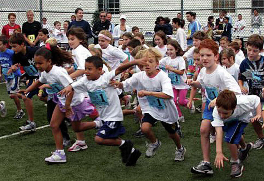The 26th annual Bigelow Tea Community 5K Road Race, along with a Kids' Fun Run (shown here in this file photo) and Fitness Walk, take place Sept. 29 at the Wakeman Boys and Girls Club. The event raises money for 17 charities. Photo: File Photo / Fairfield Citizen