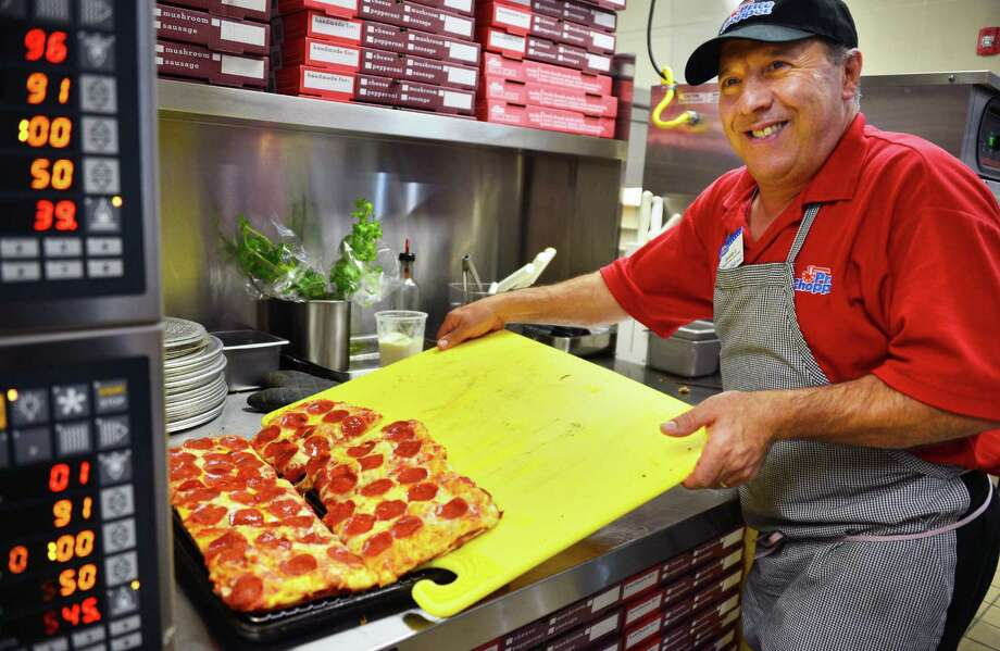 Gerardo Cunsolo prepares pizza in the new Stoned-Fired Pizza on Bistro Boulevard inside the Latham Price Chopper Wednesday Sept. 4, 2013, in Colonie, N.Y.  (John Carl D'Annibale / Times Union) Photo: John Carl D'Annibale / 00023754A