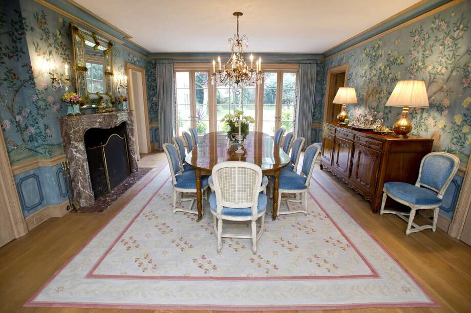 The dining room of the home at 218 Clapboard Ridge in Greenwich. Conn., complete with custom wallpaper, on Tuesday, Sept. 3, 2013. The home is up for sale with an asking price of $25 million. Photo: Lindsay Perry