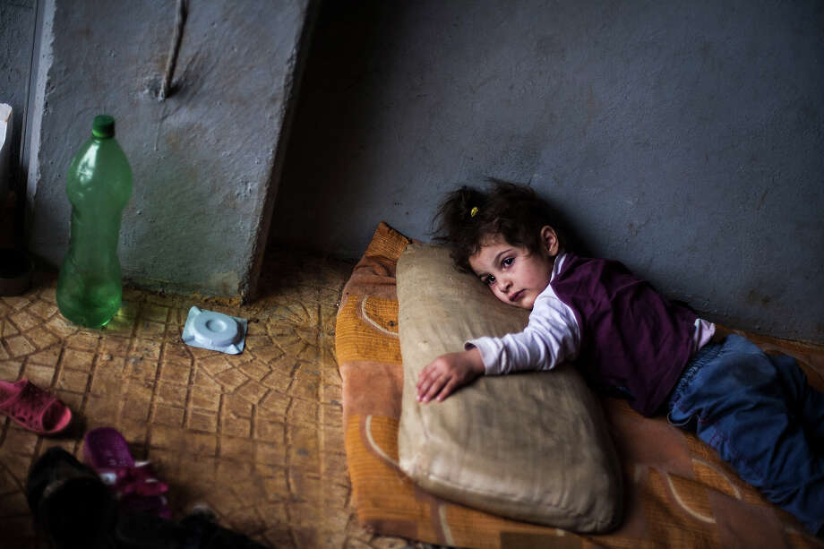 Rada Hallabi, 4, who is sick with diabetes, lies on a blanket  in a refugee camp on the border with Turkey, near Azaz village, Syria, Sunday, Sept. 30, 2012. Photo: Manu Brabo, ASSOCIATED PRESS / AP2012