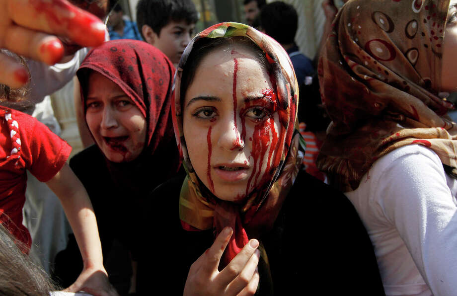 Injured Syrian women arrive at a field hospital after an air strike hit their homes in the town of Azaz on the outskirts of Aleppo, Syria, Wednesday, Aug. 15, 2012. Photo: Khalil Hamra, AP / 2012 AP
