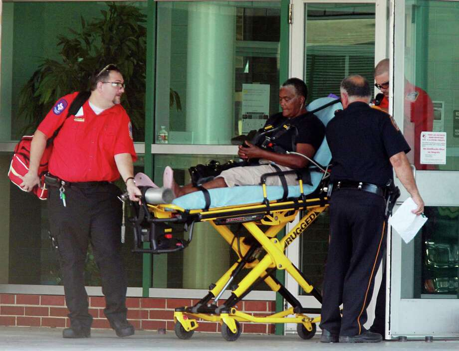 Grace Johnson, grandmother of 17-year-old student, is taken to the hospital after entering Spring High School where her grandson lost his life due to an altercation on Wednesday, Sept. 4, 2013, in Spring. Harris County Sheriff's Office is investigating. Photo: Mayra Beltran, Houston Chronicle / © 2013 Houston Chronicle