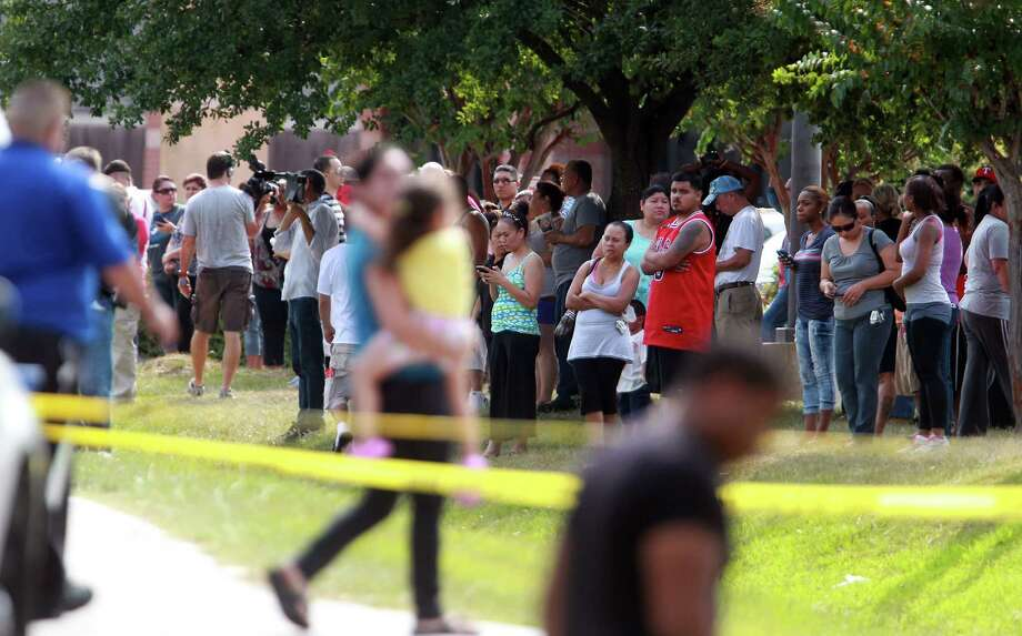 Parents wait patiently for student dismissal across the street from Spring High School after a 17 year-old student was fatal stabbed during an altercation in the cafeteria on Wednesday, Sept. 4, 2013, in Spring. Photo: Mayra Beltran, Houston Chronicle / © 2013 Houston Chronicle