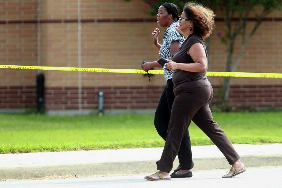 Women run across the street to Spring High School to meet the father of the 17 year-old student who was fatally stabbed during an altercation in the cafeteria on Wednesday, Sept. 4, 2013, in Spring. Photo: Mayra Beltran, Houston Chronicle / © 2013 Houston Chronicle