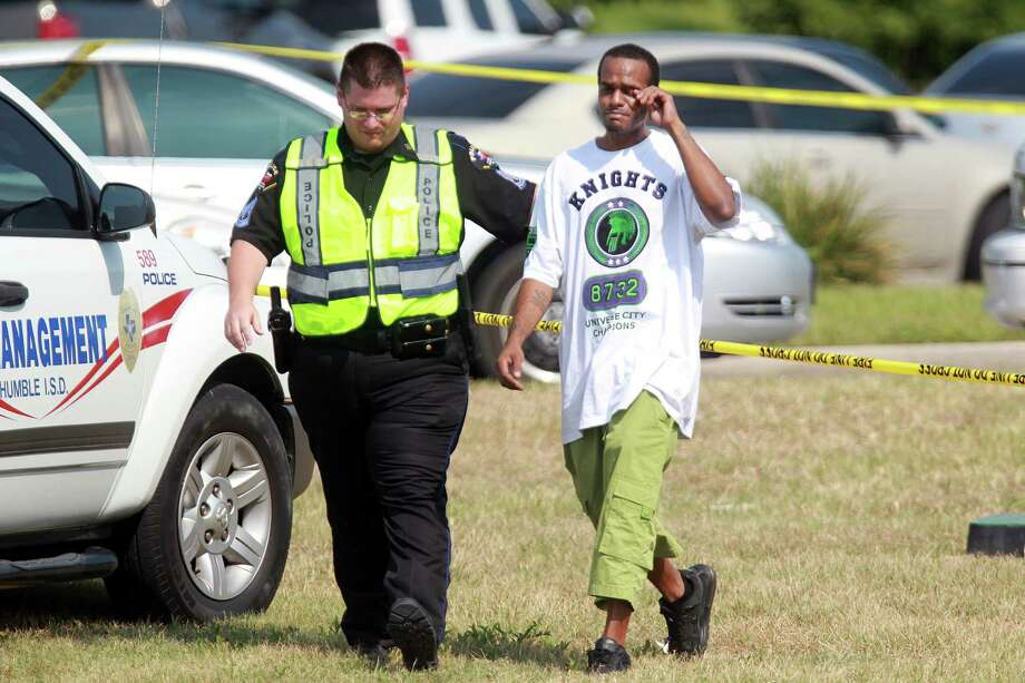 Police escorts Jason Broussard, father of the 17 year-old student who died, at Spring High School on Wednesday, Sept. 4, 2013, in Spring. Photo: Mayra Beltran, Houston Chronicle / © 2013 Houston Chronicle