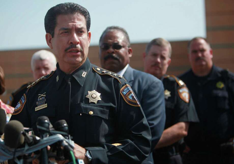 Sheriff Adrian Garcia is shown addressing the media outside Spring High School after the fatal stabbing there on Wednesday. Two days later, Garcia becomes a victim of a crime when his home is burglarized. Photo: Mayra Beltran, Houston Chronicle / © 2013 Houston Chronicle
