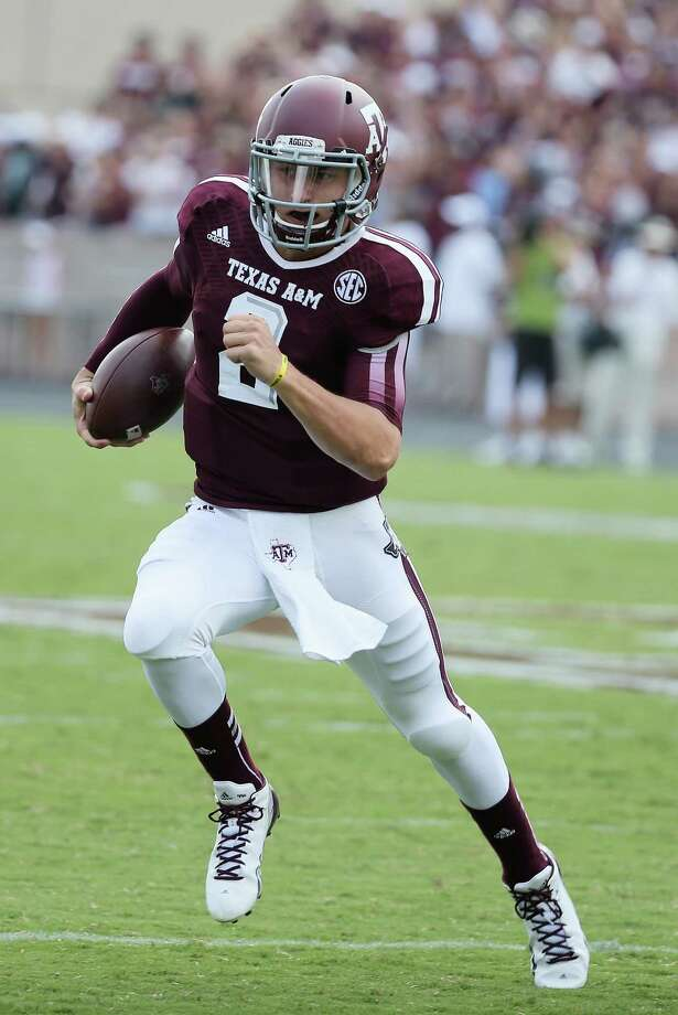 COLLEGE STATION, TX - AUGUST 31:  Johnny Manziel #2 of the Texas A&M Aggies scrambles to the sideline in the third quarter during the game against the Rice Owls at Kyle Field on August 31, 2013 in College Station, Texas.  (Photo by Scott Halleran/Getty Images) Photo: Scott Halleran, Staff / 2013 Getty Images