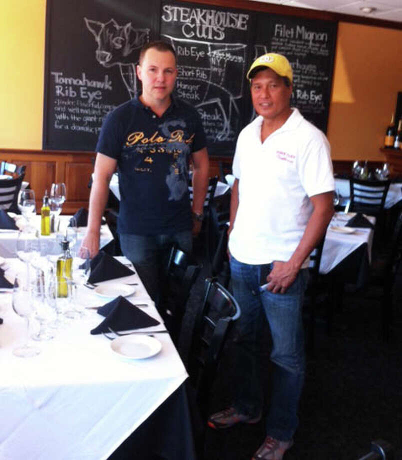 Restaurant owner Patrick Jean stands with his chef, Winnie Tognon, in the T & C Steak House. The Steak House has opened with a new menu and a new look at the same location as Jean's previous French restaurants, the Brasserie and St. Tropez at  52 Sanford St. Photo: Contributed Photo / Fairfield Citizen