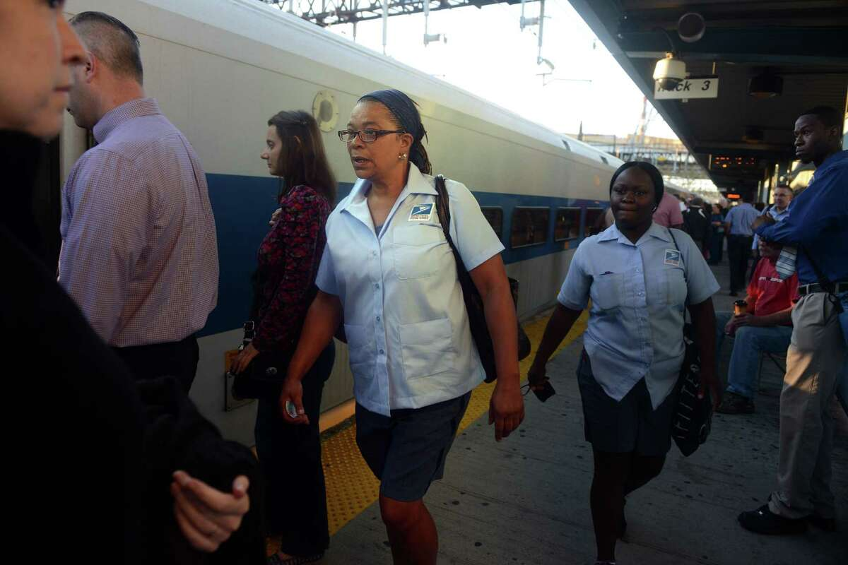 Cynthia Clarke, of Bridgeport, who was injured in the train crash in May, waits for her train with coworker Danielle Blackwood Wednesday morning Sept. 4, 2013 on her first day back to work following the crash. Clarke is a Postal Letter Carrier in Norwalk.