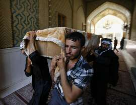 Mourners carry a coffin of a car bomb victim during the funeral in the Shiite holy city of Najaf, 100 miles (160 kilometers) south of Baghdad, Iraq, Wednesday, Sept. 4, 2013. The killings come amid a spike in deadly violence in recent months as insurgents try to capitalize on rising sectarian and ethnic tensions. The scale of the bloodshed has risen to levels not seen since 2008, a time when Iraq was pulling back from the brink of civil war. (AP Photo)