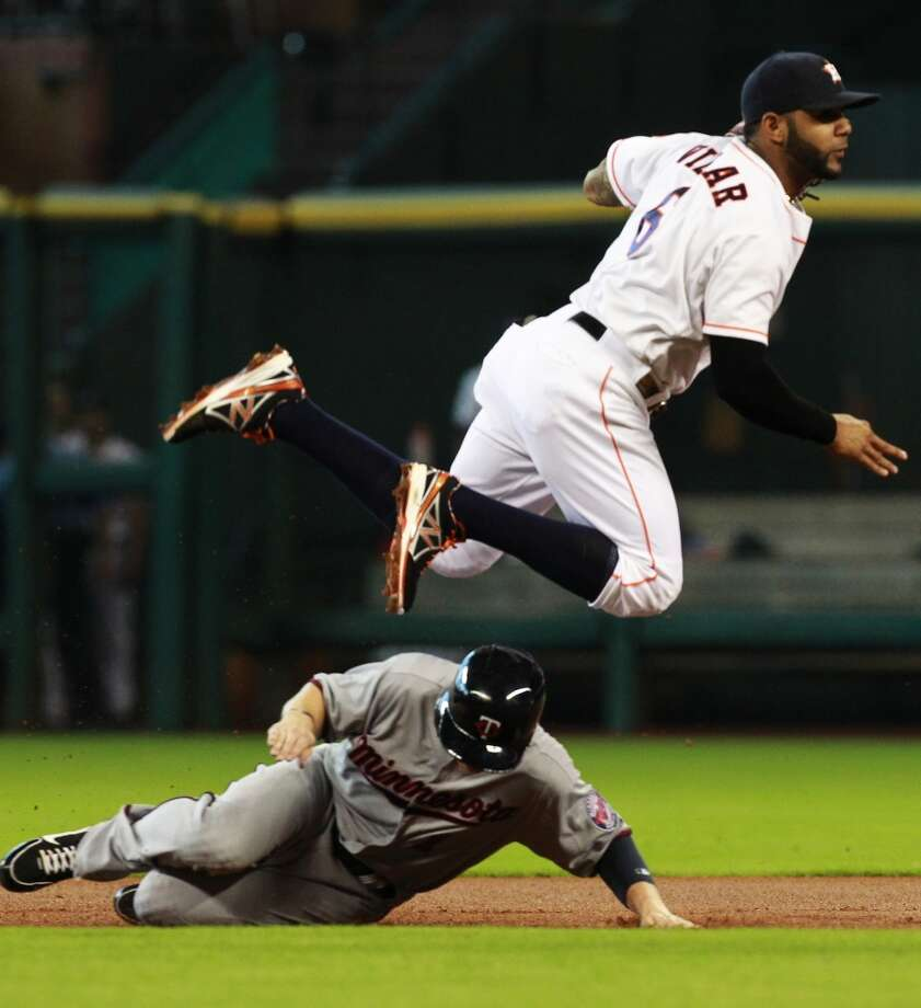 Shortstop Jonathan Villar throws to first base for a double play as Twins left fielder Alex Presley slides unsafely into second base during the first inning. Photo: Cody Duty, Chronicle