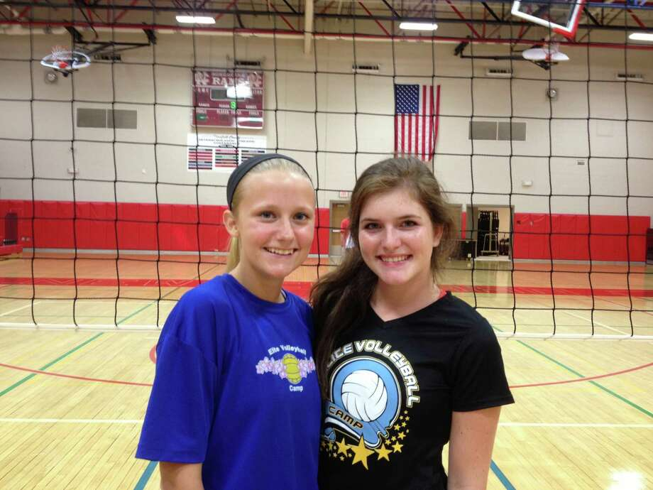 New Canaan girls volleyball captains Joanna Baran, left, and Gracie Castle pose for a picture before practice. Photo: Contributed Photo
