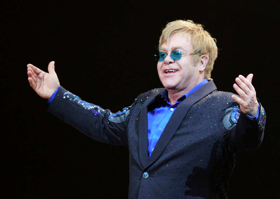 Elton John kept on playing after the air conditioning stopped working at a steamy sold-out Miami show. Photo: Eugene Hoshiko, STF / AP