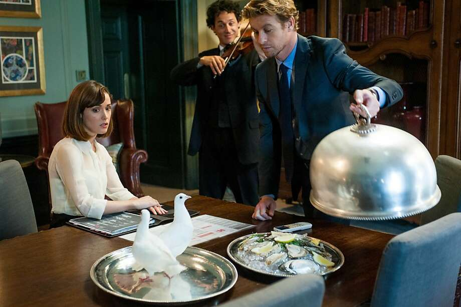 "The married Nat (Rose Byrne) ends up finding herself attracted to a rich businessman, played by Simon Baker (right), in ""I Give It a Year."" Photo: Liam Daniel, Magnolia Pictures"