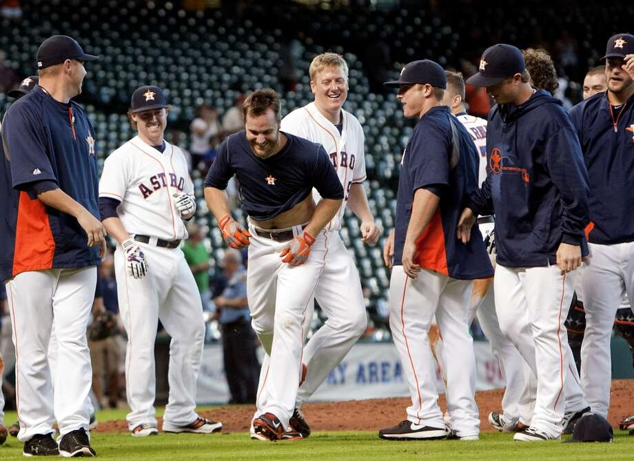 Sept. 4: Astros 6, Twins 5 Trevor Crowe makes his way from the bottom of the dog pile after his walk-off hit. Photo: Cody Duty, Chronicle