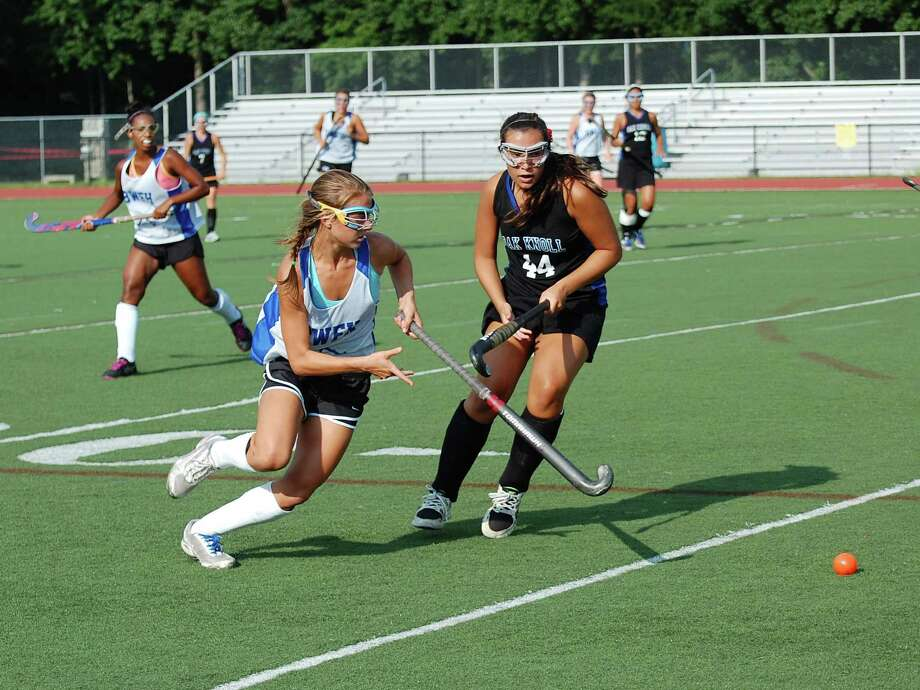 Darien's Marissa Baker chases down the ball in a preseason scrimmage against Oak Knoll on Thursday, Aug. 29 at Darien High School. The Blue Wave won the scrimmage 3-2. By Dave Crandall. Photo: Contributed Photo
