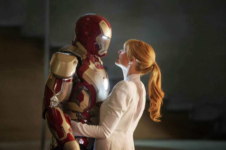 "Robert Downey Jr. (left) as Tony Stark/Iron Man and Gwyneth Paltrow as Pepper Potts in ""Iron Man 3,"" the summer movie season's top moneymaker in a season when making money is a movie-biz fundamental."