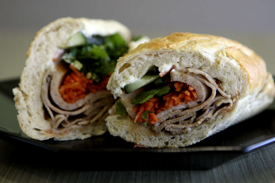 This classic Vietnamese sandwich, the banh mi, is from the House of Pho. Photo: Express-News File Photos