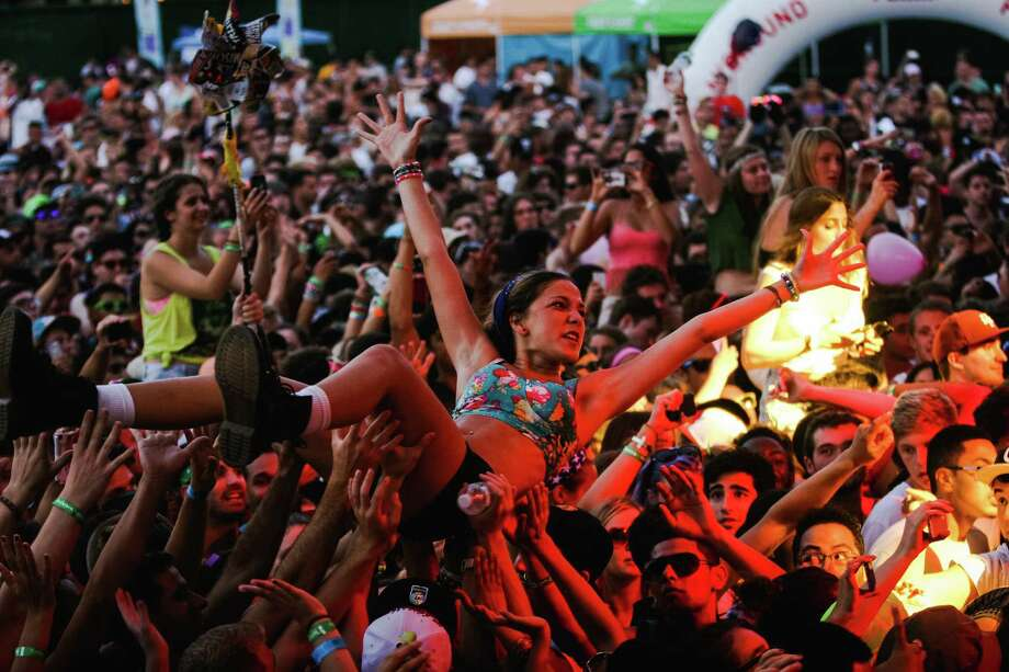 The atmosphere is definitely partylike at the Mad Decent Block Party at Williamsburg Park  in Brooklyn, N.Y., last month. Photo: Roger Kisby / Getty Images