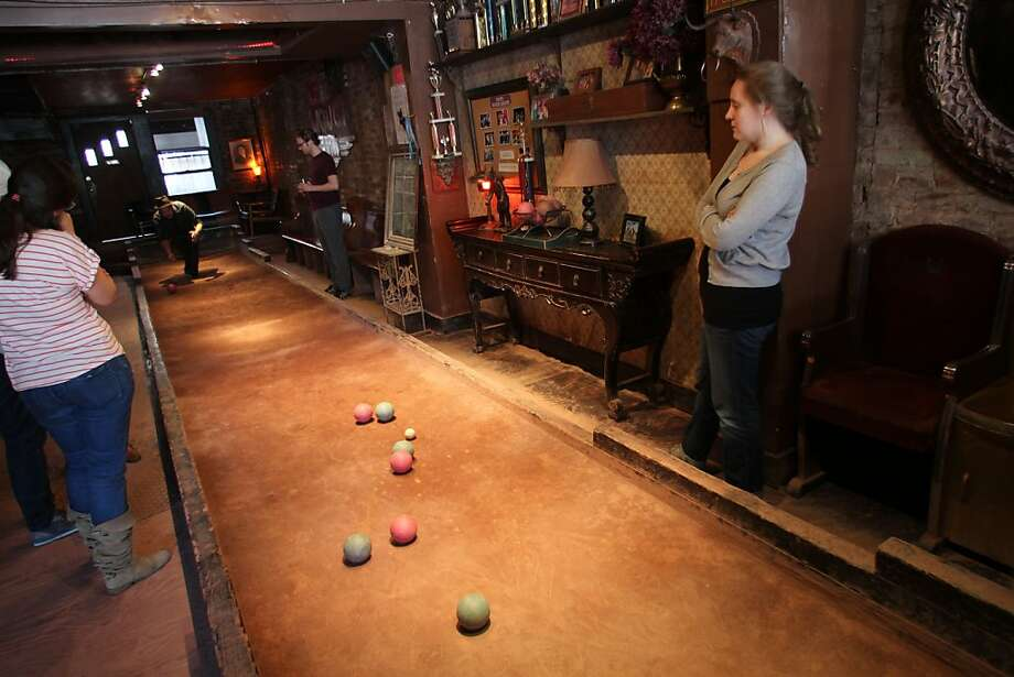 Bar patrons compete on the full-size bocce court in Floyd, one of a few dozen hip pubs, cafes and boutiques that now populate Atlantic Avenue in Brooklyn. Photo: Spud Hilton, The Chronicle