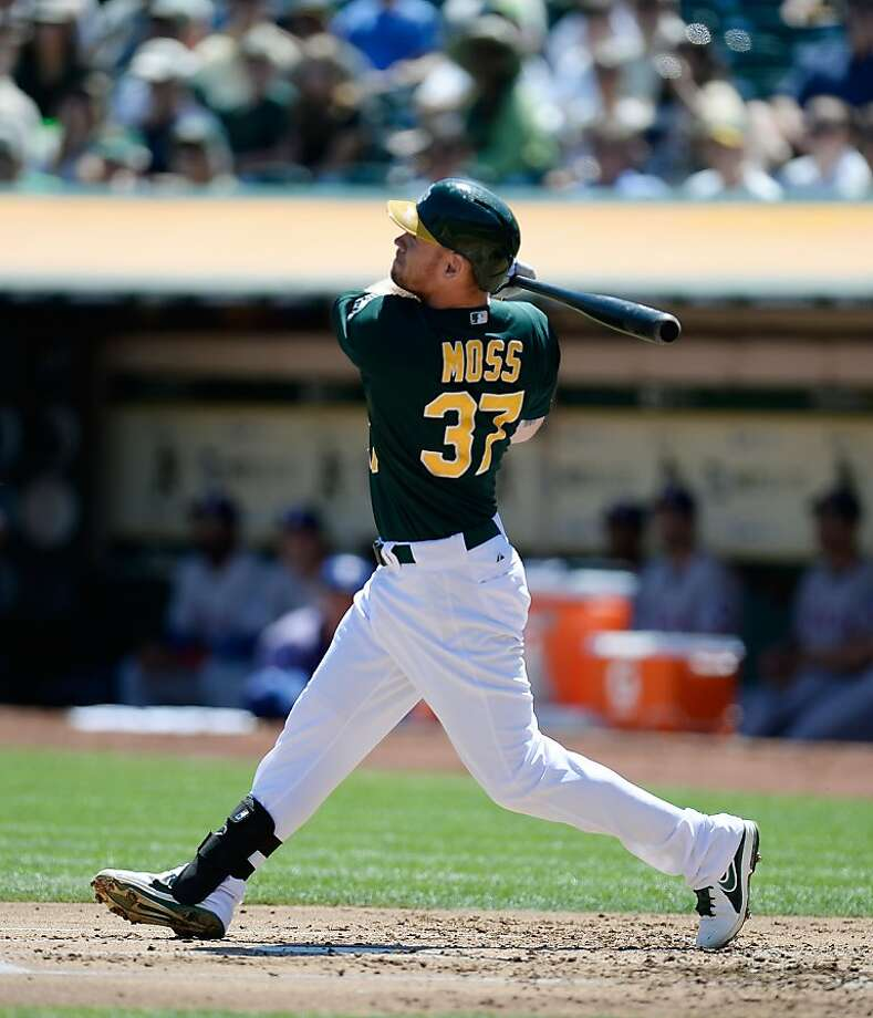Brandon Moss puts the A's ahead with his two-run homer off Yu Darvish in the first. It was Moss' fifth homer in nine games. Photo: Thearon W. Henderson, Getty Images