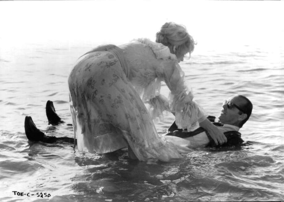 Shirley MacLaine helps Jack Nicholson out of the water in a scene from the film 'Terms Of Endearment', 1983. (Photo by Metro-Goldwyn-Mayer/Getty Images) Photo: Archive Photos, Getty Images / 2012 Getty Images