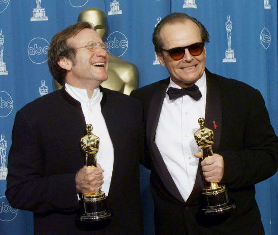 "Oscar winners Robin Williams (L), Best Supporting Actor and Jack Nicholson (R), Best Actor pose for photographers 23 March at the 70th Annual Academy Awards at the Shrine Auditorium in Los Angeles. Williams won for his roll in ""Good Will Hunting"" and Nicholson for ""As Good As It Gets.""  (ELECTRONIC IMAGE)    AFP PHOTO/Hector MATA (Photo credit should read HECTOR MATA/AFP/Getty Images) Photo: HECTOR MATA, AFP/Getty Images / AFP"