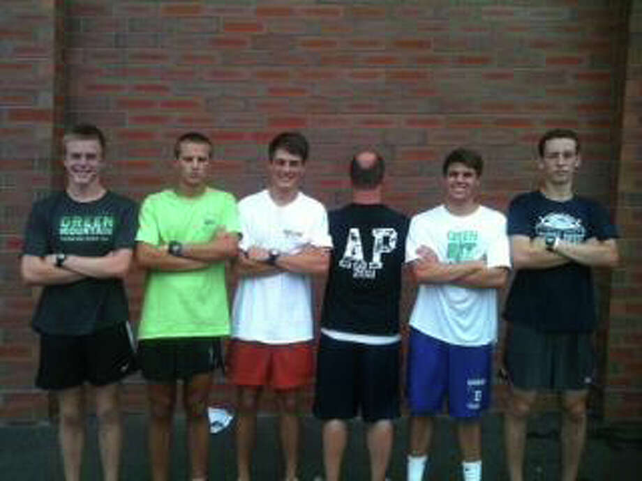 From left, Darien cross country captains Marshall Huffman, Peter Kreuch, Colten Appley, honorary captain Andy Pena represented with AP initials, Ben Olsen and Brian Davey pose for a picture. Photo: Contributed Photo