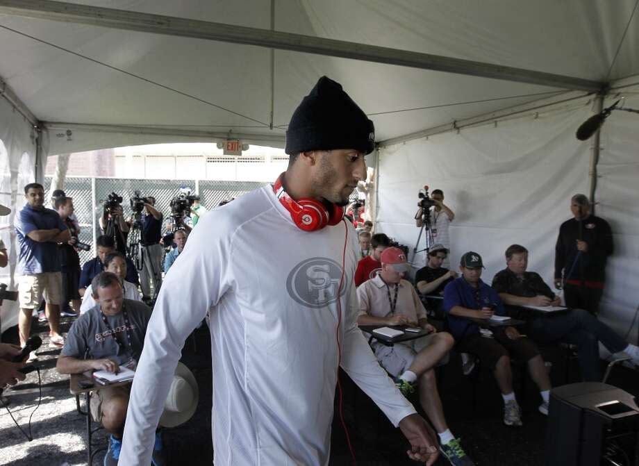 Quarterback Colin Kaepernick, (7) makes his way to the podium as he meets with the news media during a press conference at the San Francisco 49ers training camp in Santa Clara, Calif. on Thursday July 25, 2013. Photo: Michael Macor, San Francisco Chronicle