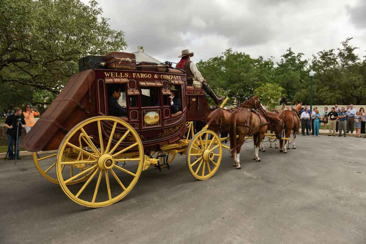 A Wells Fargo stage coach driven by Alan Cartwright arrives with dignitaries for the 20th anniversary celebration for the Hyatt Regency Hill Country Resort and Spa Monday.