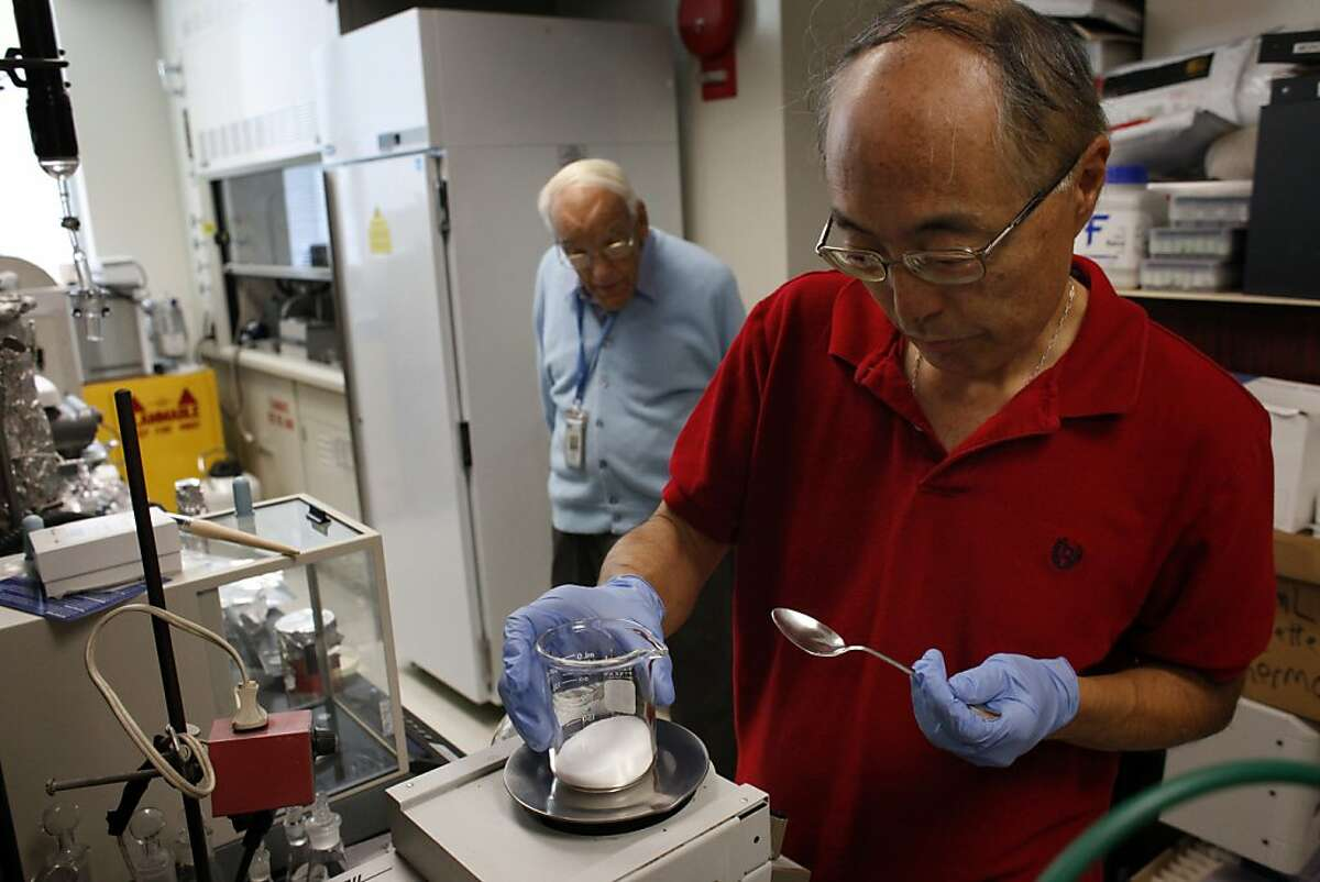 Scientist Ron Buttery, left watches as Gary Takeoka, Research Chemist with the United States Department of Agriculture, prepares to extract the volatiles in black olives to understand the quality and compare it to that of domestic and non-domestic olives, Friday August 30, 2013, in Albany, Calif.