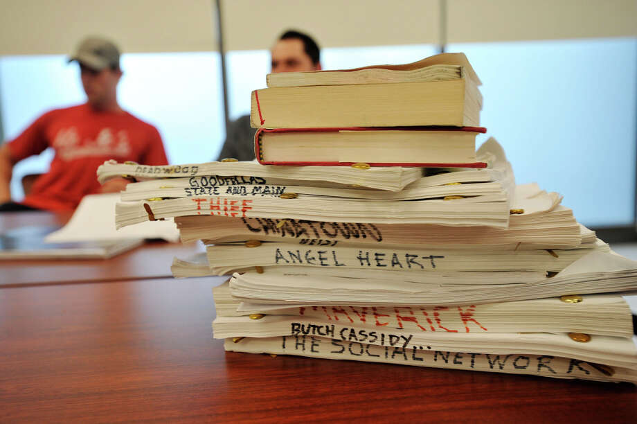 A stack of finished screenplays lays on the table ready to be handed out as reading assignments during Sacred Heart University's new film class at their Landmark Square campus in Stamford, Conn., on Wednesday, Sept. 4, 2013. Photo: Jason Rearick / Stamford Advocate
