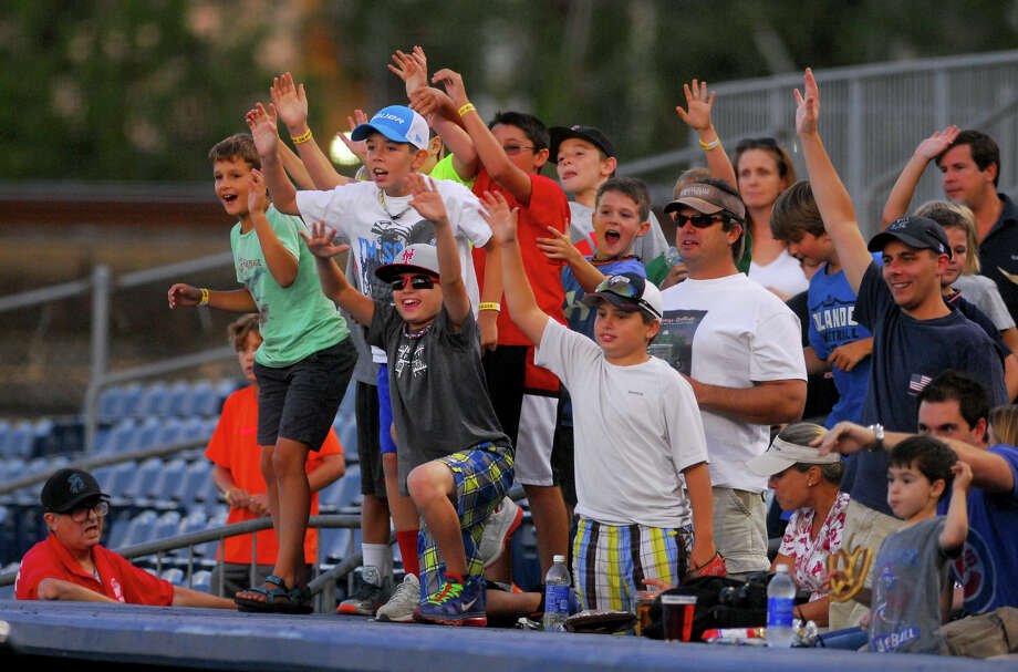 Young fans try to get mascott B.B. the Bluefish's attention to throw them a T-shirt during Bluefish game action against the Sugar Land Skeeters at the Ballpark at Harbor Yard in Bridgeport, Conn. on Wednesday September 4, 2013. Photo: Christian Abraham / Connecticut Post