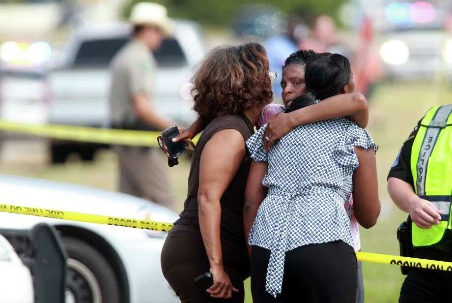 Women who knew the deceased young man embrace outside Spring High School on Wednesday, Sept. 4, 2013, in Spring. Photo: Mayra Beltran, Houston Chronicle / © 2013 Houston Chronicle