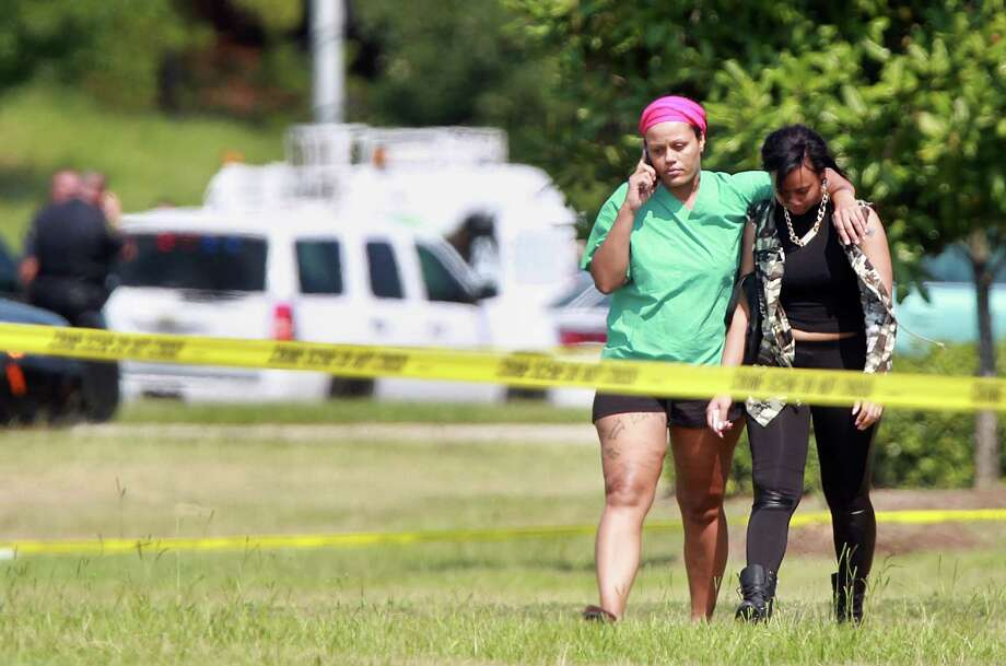 Women walk away from Spring High School where a 17 year-old student was fatally stabbed during an altercation in the cafeteria on Wednesday, Sept. 4, 2013, in Spring. Photo: Mayra Beltran, Houston Chronicle / © 2013 Houston Chronicle