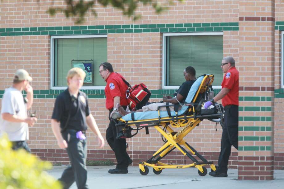 Paramedics remove a person from Spring High School after an apparent fatal stabbing occurred at the school on Wed., Sept. 4. Photo: Mayra Beltran, Chronicle