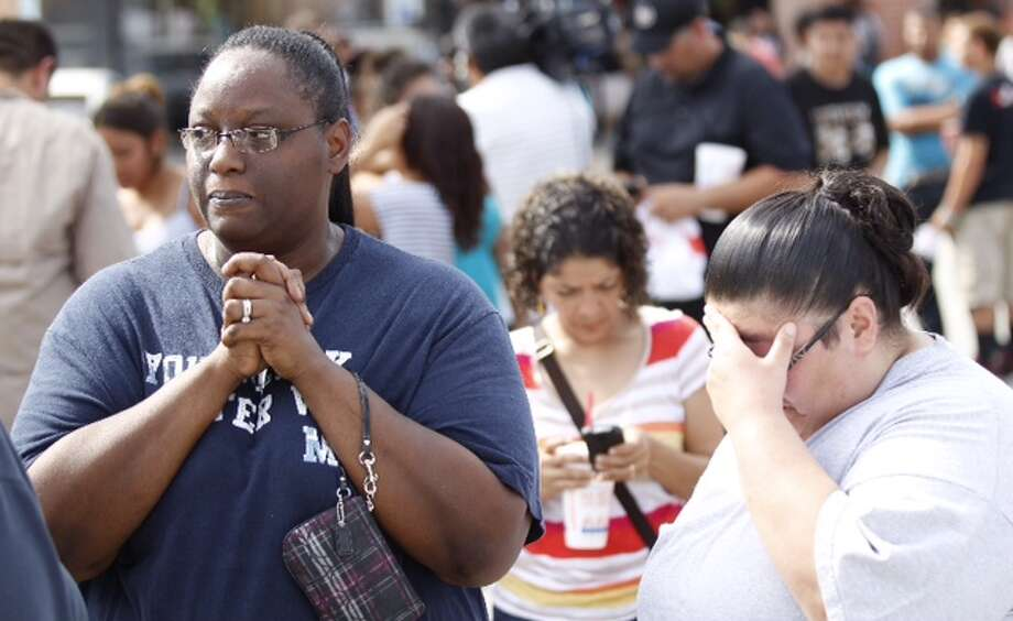 People wait outside while police investigate a fatal stabbing at Spring High School on Wed., Sept. 4.  Photo: Brett Coomer, Chronicle