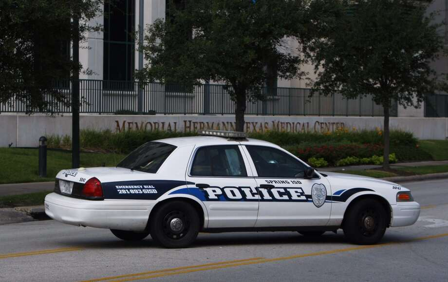 A Spring ISD police car leaves Memorial Hermann hospital on Wed., Sept. 4. Police are investigating a fatal stabbing at Spring High School. Photo: Cody Duty, Chronicle