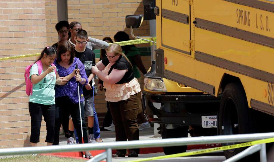 Students are loaded onto a bus outside Spring High School Wednesday, Sept. 4, 2013, in Spring, Texas. A 17-year-old student was stabbed to death and three others are injured after a fight at a Houston-area high school. (AP Photo/David J. Phillip) Photo: David J. Phillip, Associated Press / AP