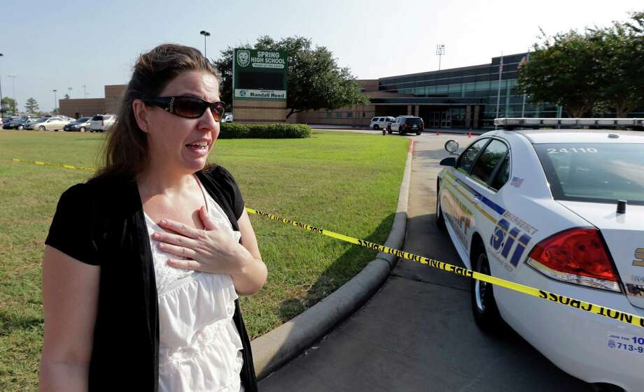 Nancy Clark becomes emotional as she talks about her son as she waits for him outside Spring High School Wednesday, Sept. 4, 2013, in Spring, Texas.  A 16-year-old boy has been airlifted from the school in suburban Houston with stab wounds suffered in an altercation at the campus. The Harris County Sheriff's Office says it responded about 7 a.m. Wednesday to Spring High School to a report of a stabbing. Spring is about 20 miles north of Houston. Photo: AP