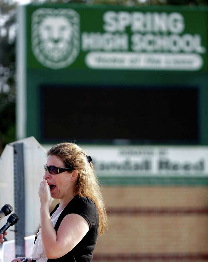 Nancy Clark wipes her face as she talks about her son as she waits for an update outside Spring High School Wednesday, Sept. 4, 2013, in Spring, Texas.  A 16-year-old boy has been airlifted from the school in suburban Houston with stab wounds suffered in an altercation at the campus. The Harris County Sheriff's Office says it responded about 7 a.m. Wednesday to Spring High School to a report of a stabbing. Spring is about 20 miles north of Houston. Photo: AP