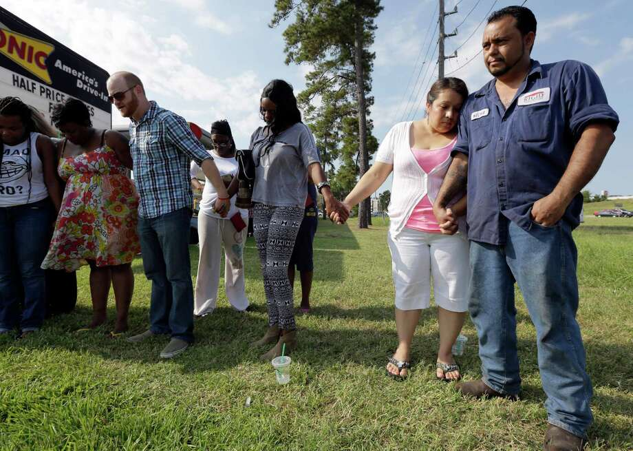 Veronica Gonzalez, right, puts her head on the shoulder of her husband, Walter Gonzalez, as they pray while waiting for their daughter and niece outside Spring High School, Wednesday, Sept. 4, 2013, in Spring, Texas.  At least one person has been killed and others injured in an altercation at the high school in suburban Houston. The Harris County Sheriff's Office did not say whether the people involved in the fight about 7 a.m. Wednesday at Spring High School were all students. Photo: AP